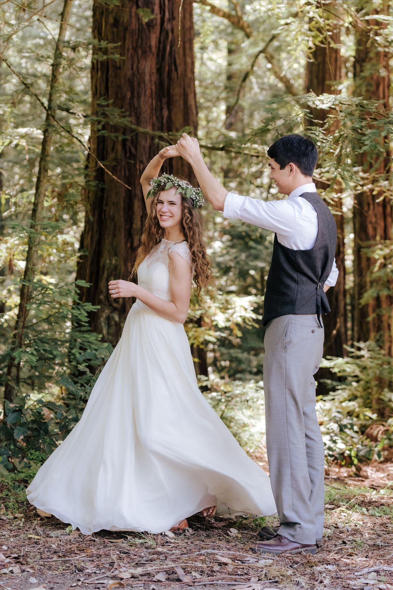 FW-6667.JPGMt Madonna wedding in the redwoods outside of Watsonville, California with a romantic and classic vibe by sarah williams of mirror's edge photography a san luis obispo wedding photographer.  Bride and Groom dancing in the forest