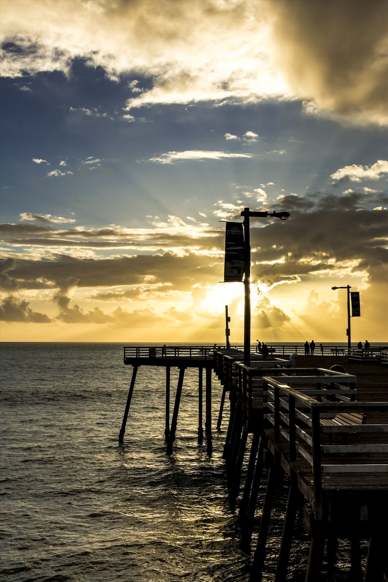 Pismo Pier Sunrays.jpg - Sunset sun rays say good evening to Pismo Beach pier by Sarah Williams