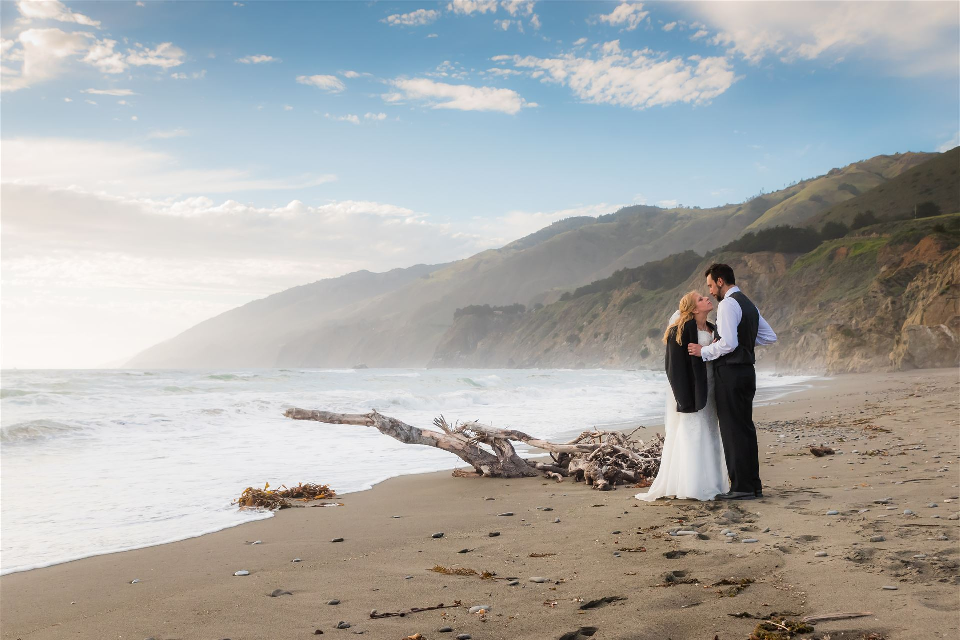 Adele and Jason 27 - Ragged Point Inn Wedding Elopement photography by Mirror's Edge Photography in San Simeon Cambria California. Bride and Groom at Ragged Point Beach at sunset by Sarah Williams