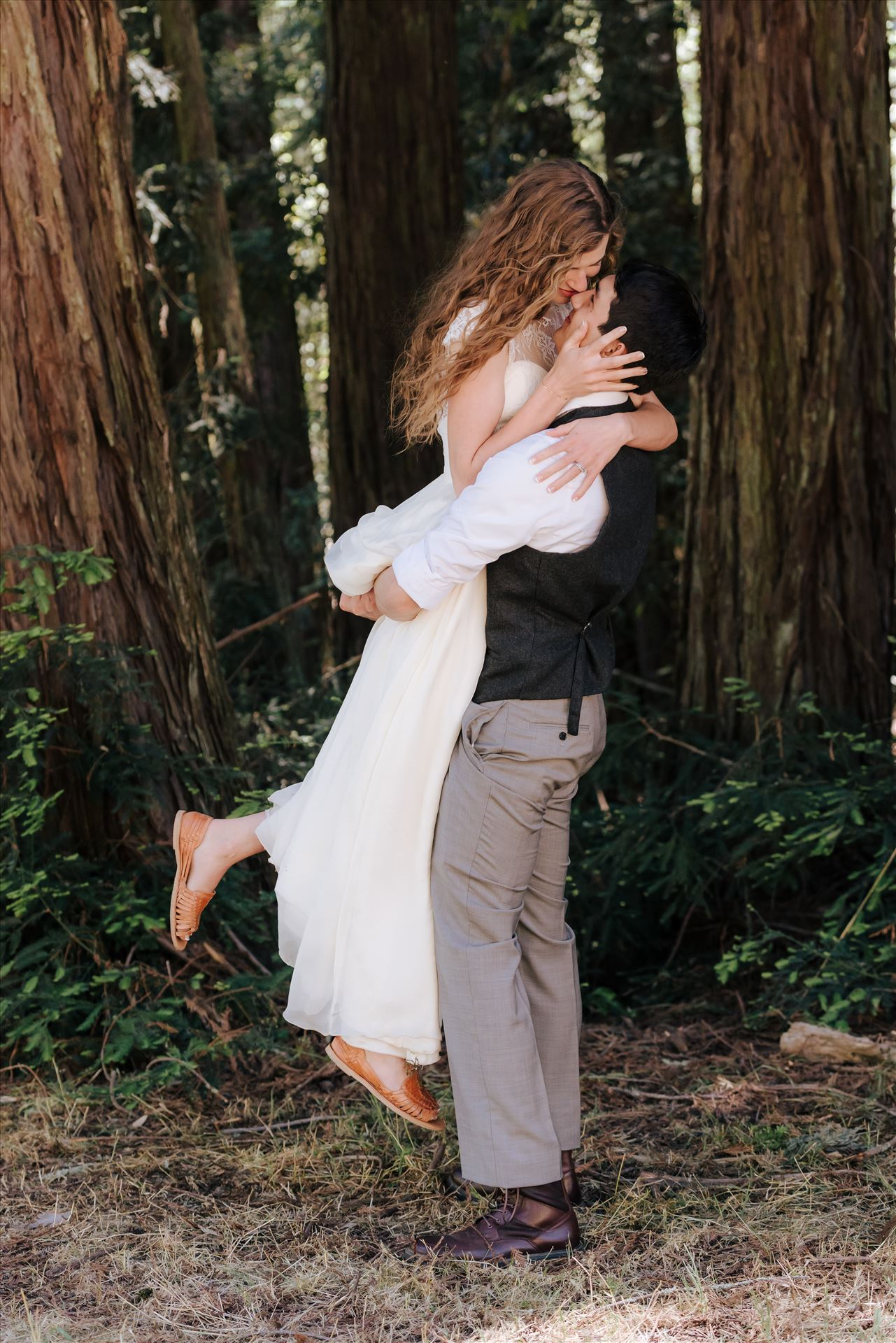 FW-6277.JPGMt Madonna wedding in the redwoods outside of Watsonville, California with a romantic and classic vibe by sarah williams of mirror's edge photography a san luis obispo wedding photographer.  Groom lifts Bride