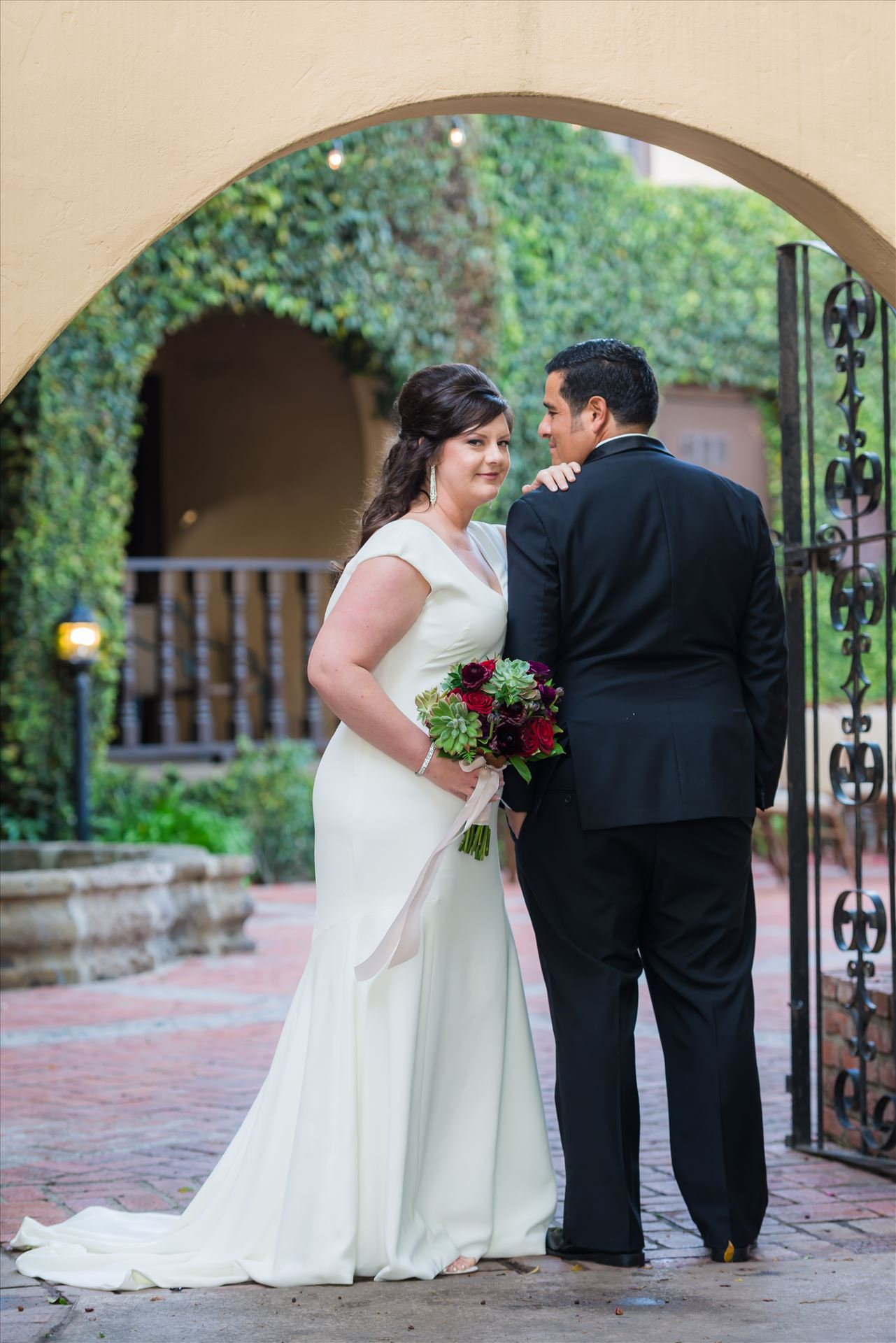 Mary and Alejandro 19 - Wedding photography at the Historic Santa Maria Inn in Santa Maria, California by Mirror's Edge Photography. Bride and Groom Hidden Courtyard. by Sarah Williams