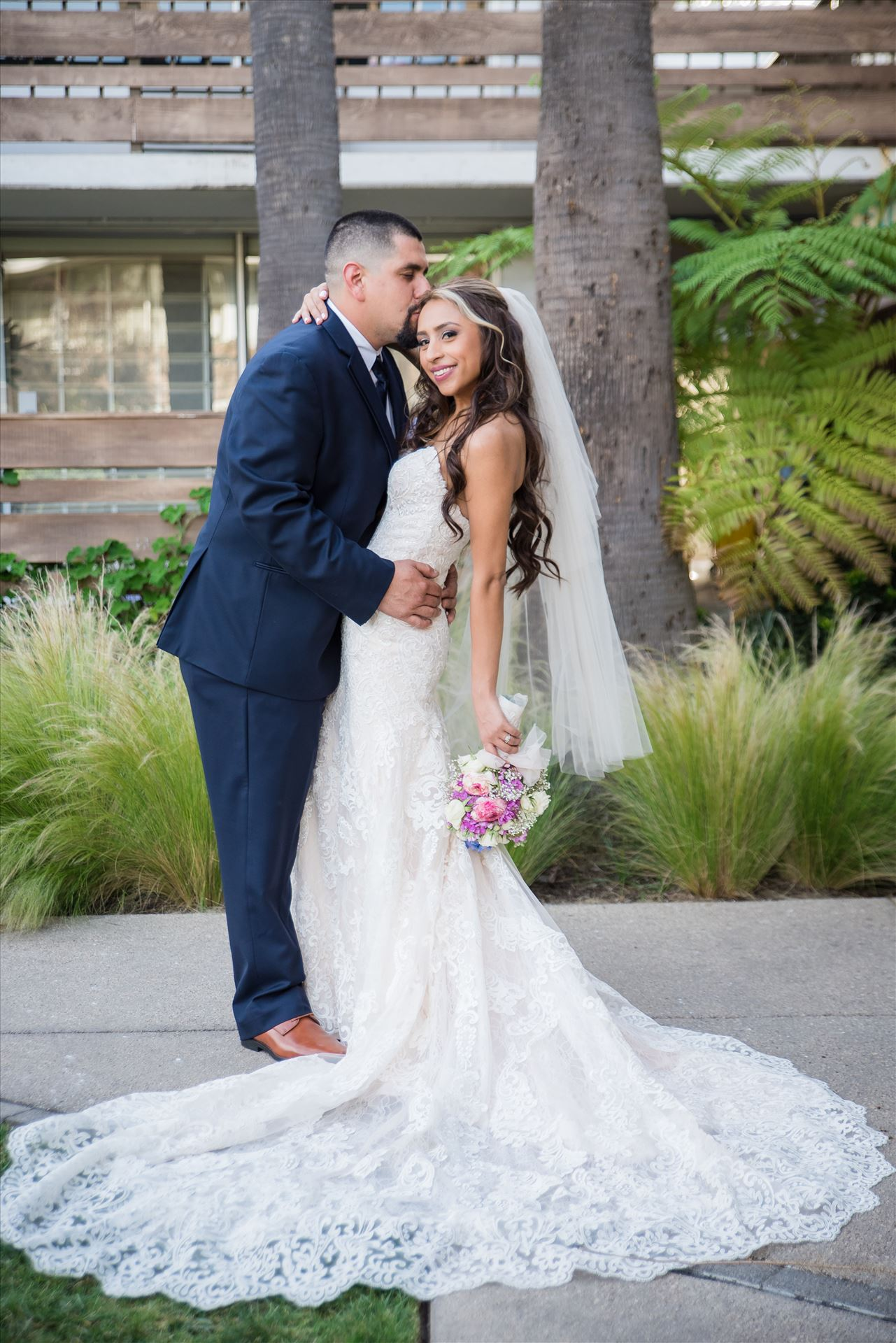 Ana and Juan 41 - Wedding photography at the Kimpton Goodland Hotel in Santa Barbara California by Mirror's Edge Photography.  Classic Bride and Groom by Sarah Williams