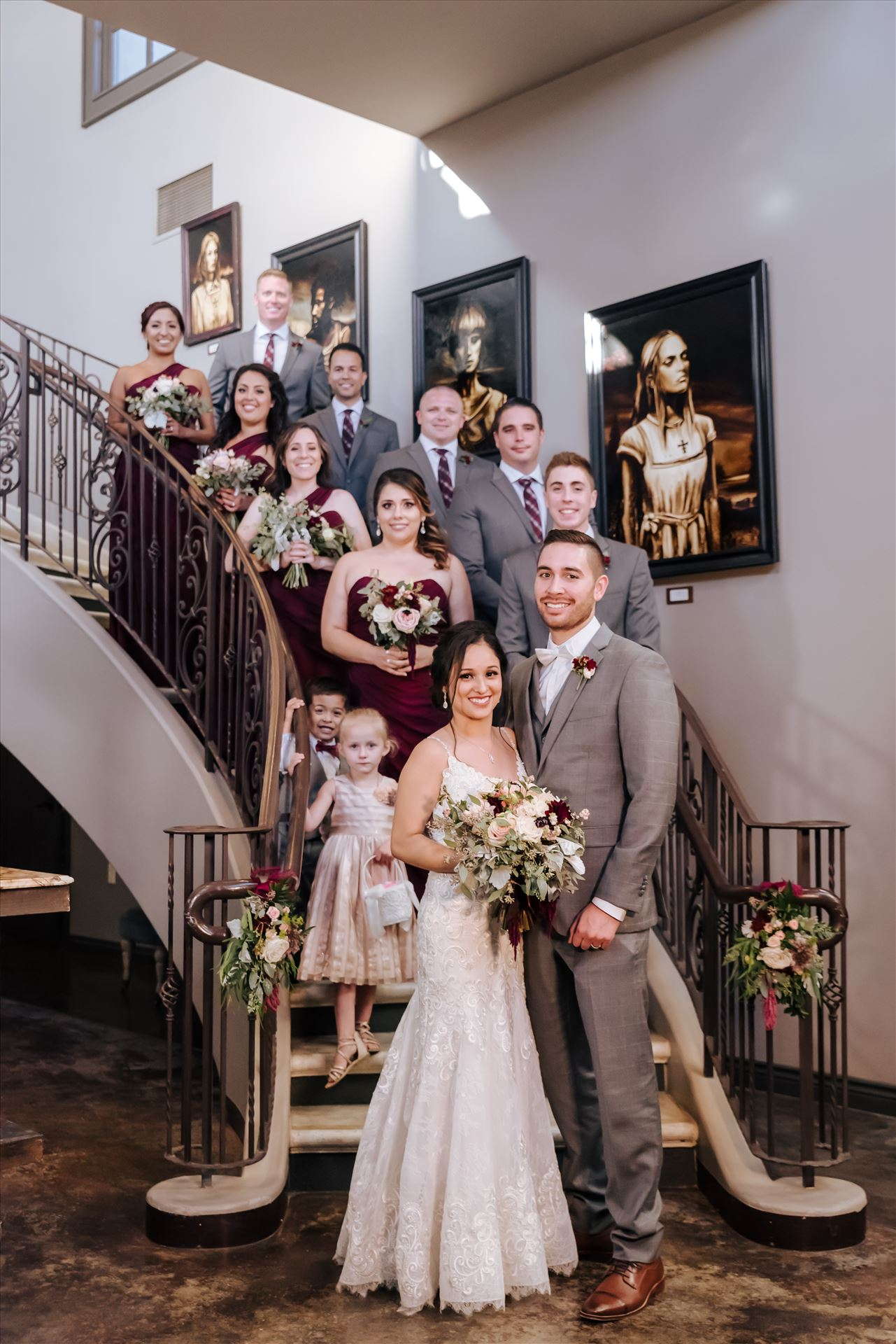 Edith and Kyle 128 - Mirror's Edge Photography captures Edith and Kyle's wedding at the Tooth and Nail Winery in Paso Robles California. Bride, Groom and Bridal Party on Tasting Room staircase by Sarah Williams