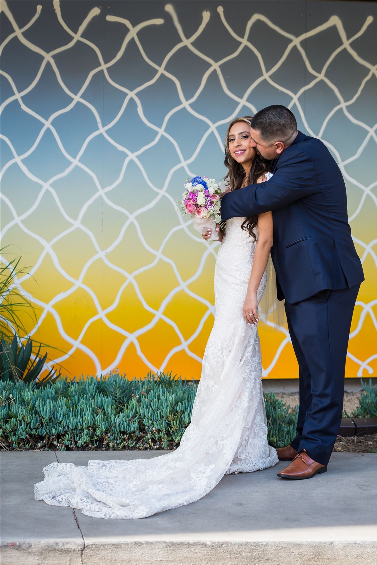 Ana and Juan 40 - Wedding photography at the Kimpton Goodland Hotel in Santa Barbara California by Mirror's Edge Photography.  Retro Bride and Groom by Art Wall by Sarah Williams
