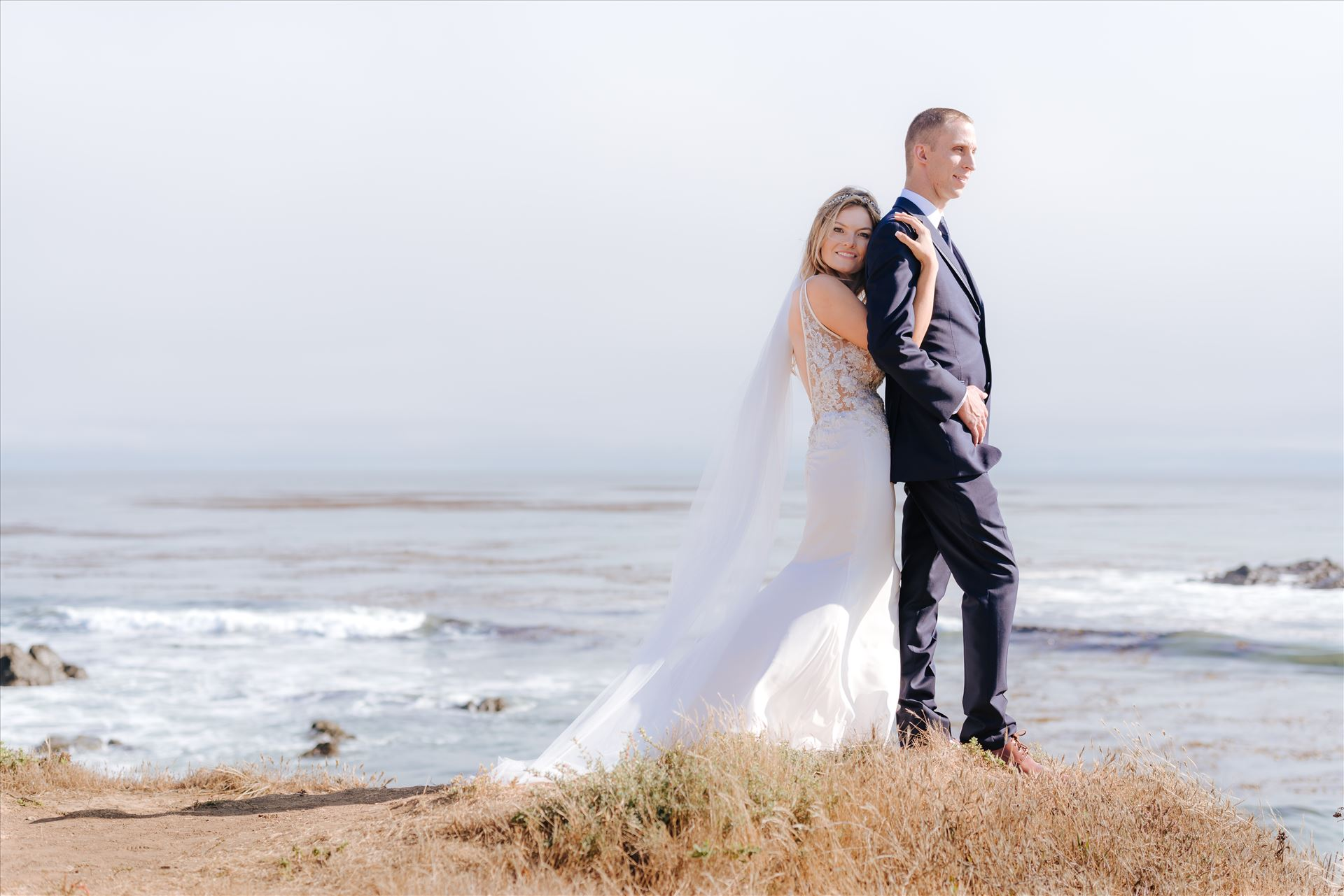 Courtney and Doug 55 - Mirror's Edge Photography, San Luis Obispo Wedding Photographer captures Cayucos Wedding on the beach and bluffs in Cayucos Central California Coast. Bride and Groom overlooking the ocean by Sarah Williams