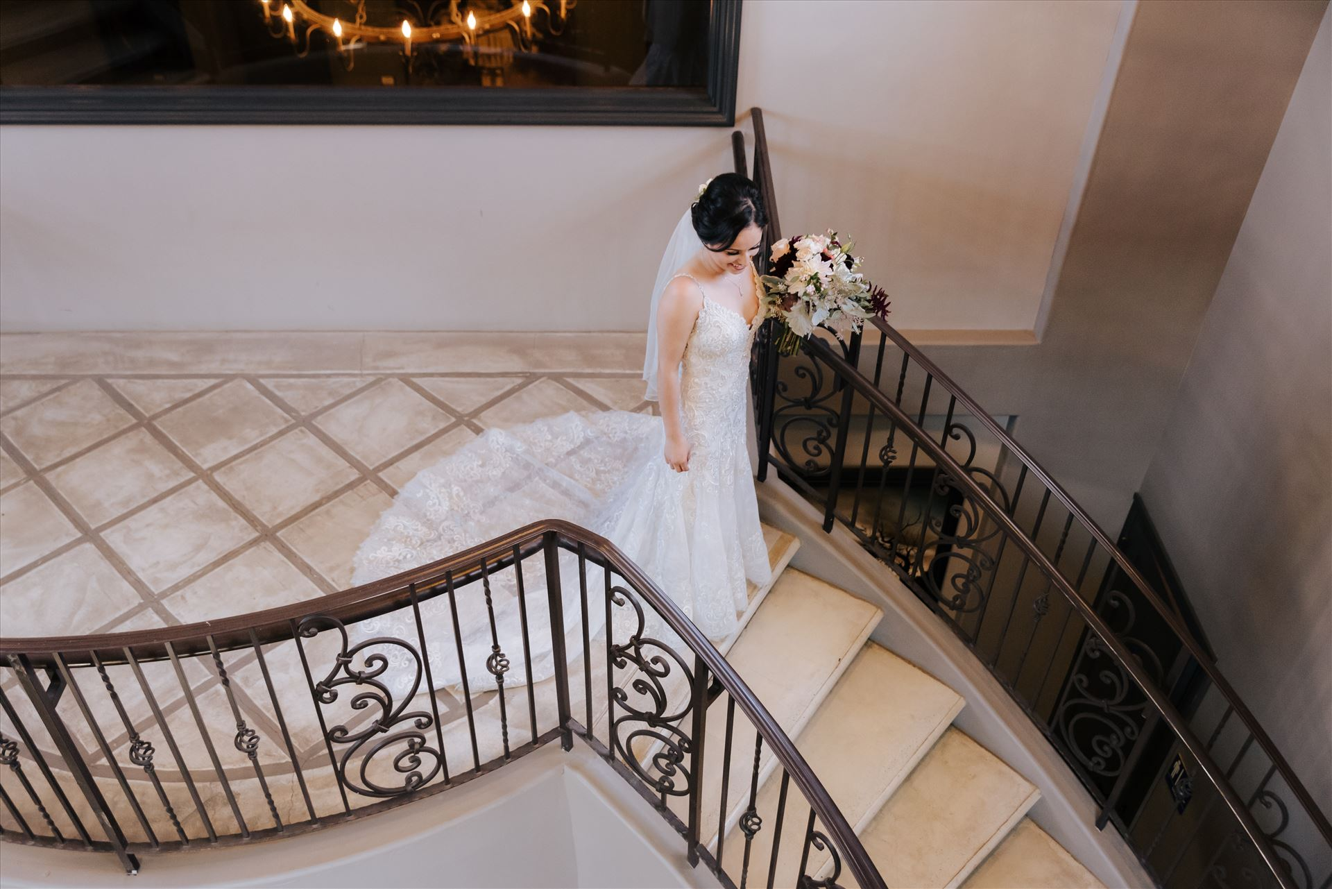 Edith and Kyle 011 - Mirror's Edge Photography captures Edith and Kyle's wedding at the Tooth and Nail Winery in Paso Robles California. Bride getting ready for the First Look on the stairs by Sarah Williams