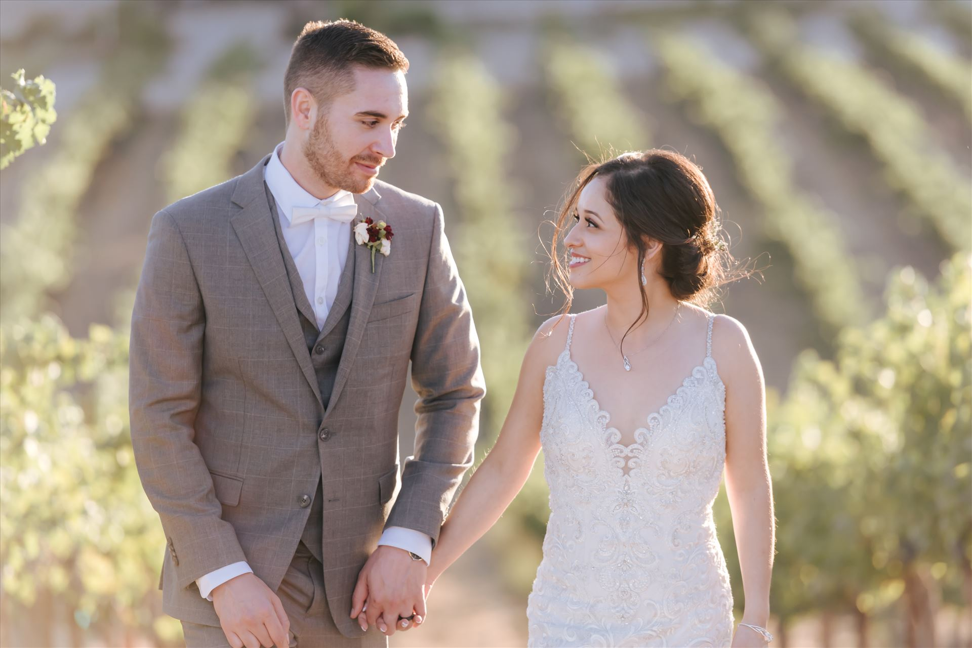 FW-6933.JPG - Tooth and Nail Winery elegant and formal wedding in Paso Robles California wine country by Mirror's Edge Photography, San Luis Obispo County Wedding Photographer. Bride and Groom walking through the vineyards in Paso Robles California wine country wedding by Sarah Williams