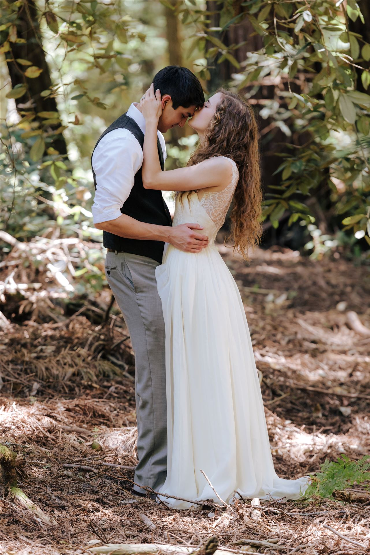 FW-6044.JPG - Mt Madonna wedding in the redwoods outside of Watsonville, California with a romantic and classic vibe by sarah williams of mirror's edge photography a san luis obispo wedding photographer.  Bride kisses groom in the trees by Sarah Williams