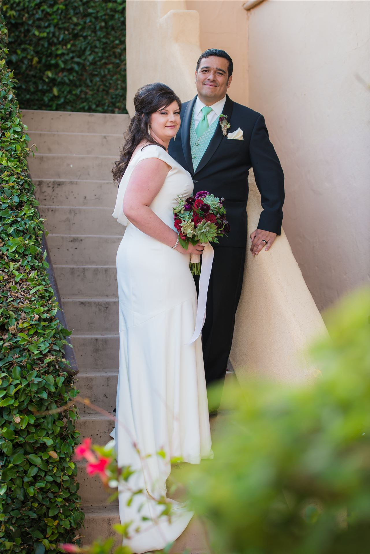 Mary and Alejandro 16 - Wedding photography at the Historic Santa Maria Inn in Santa Maria, California by Mirror's Edge Photography. Bride and Groom on the Ivy Staircase after Ceremony. by Sarah Williams
