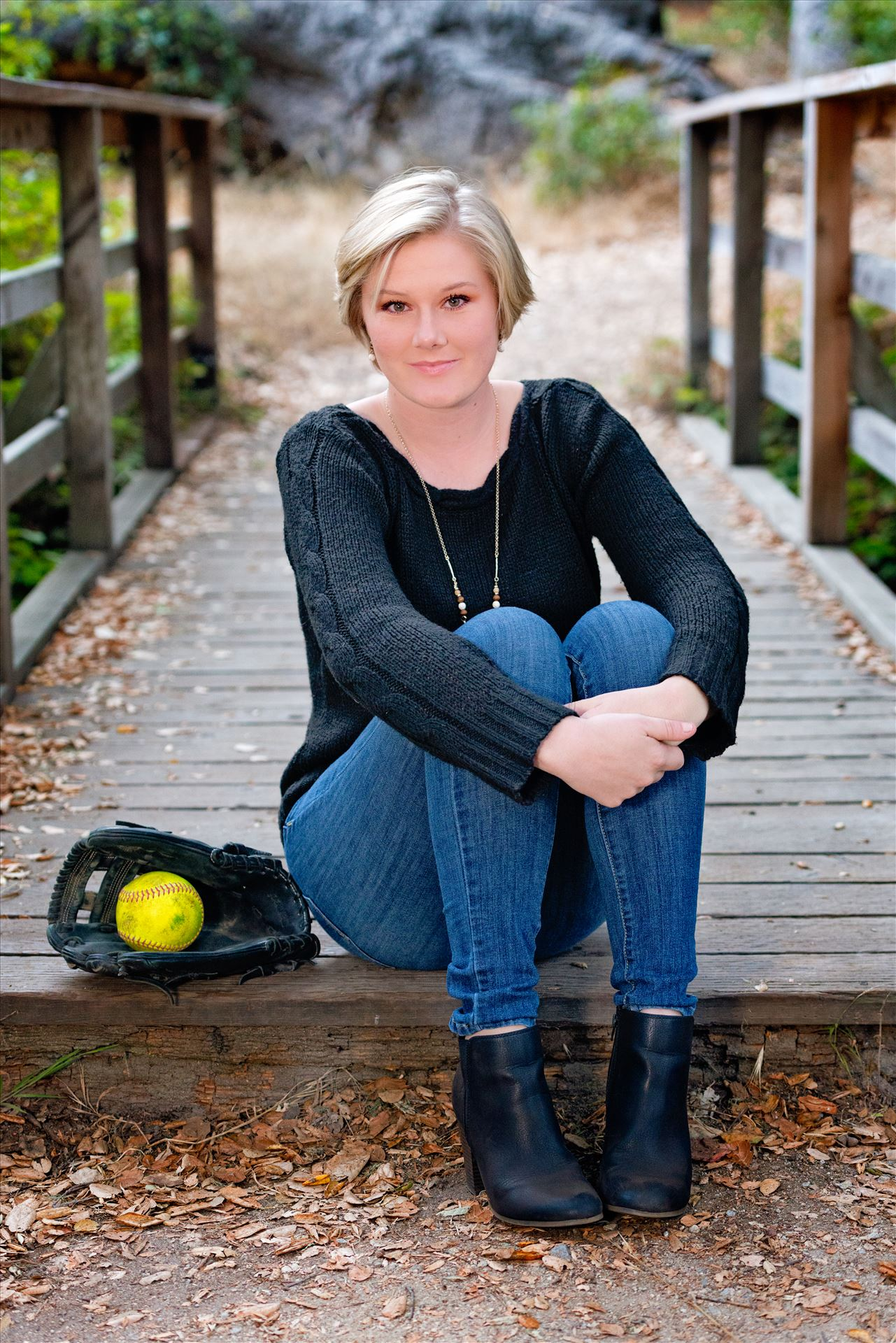 Ariel Ingram Senior Portraits 25 - Senior Portrait Session 2018 at Los Osos Oaks Reserve.  San Luis Obispo and Central Coast Senior Portrait photographer Mirror's Edge Photography. Senior with softball prop by Sarah Williams