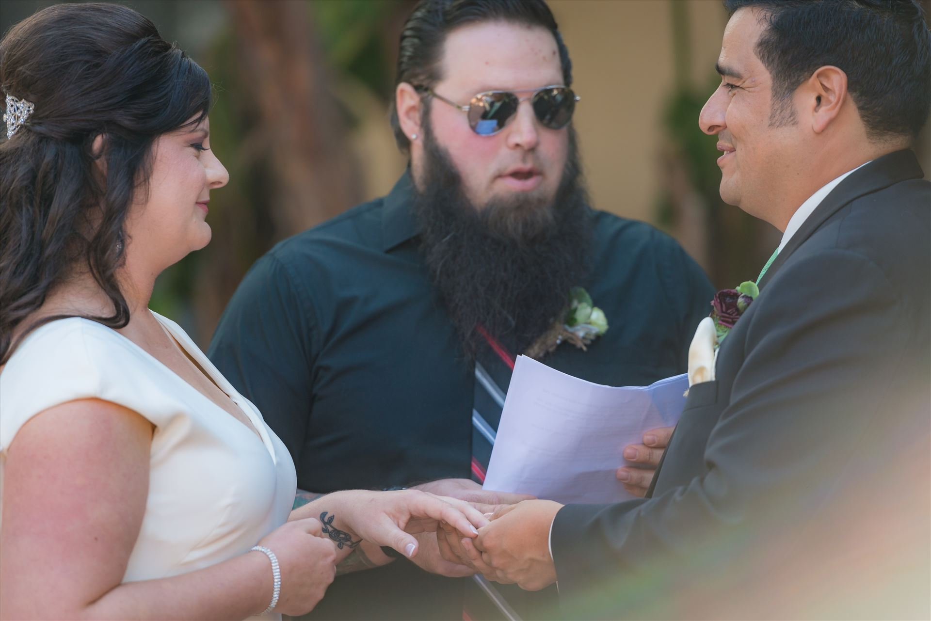 Mary and Alejandro 28 - Wedding photography at the Historic Santa Maria Inn in Santa Maria, California by Mirror's Edge Photography. Saying their vows. by Sarah Williams
