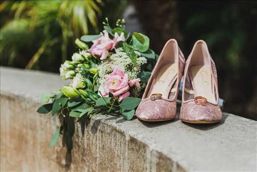 Wedding at Dolphin Bay Resort and Spa in Shell Beach, California by Sarah Williams of Mirror's Edge Photography, a San Luis Obispo County Wedding Photographer. Rings and shoes at Dolphin Bay Resort