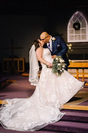 Sarah Williams of Mirror's Edge Photography and San Luis Obispo and Santa Barbara Wedding Photographer captures the Ochoa Wedding. Bride and Groom Kiss at Trinity Church.