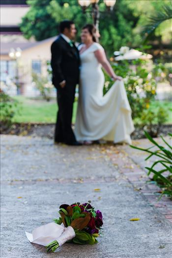 Wedding photography at the Historic Santa Maria Inn in Santa Maria, California by Mirror's Edge Photography. Bouquet and the Bride and Groom.