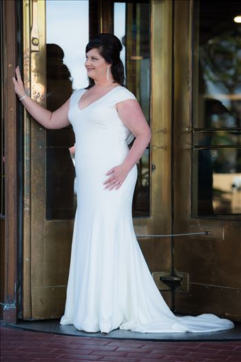 Wedding photography at the Historic Santa Maria Inn in Santa Maria, California by Mirror's Edge Photography. Beautiful Bride and the revolving door.