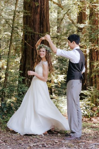 Mt Madonna wedding in the redwoods outside of Watsonville, California with a romantic and classic vibe by sarah williams of mirror's edge photography a san luis obispo wedding photographer.  Bride and Groom dancing in the forest