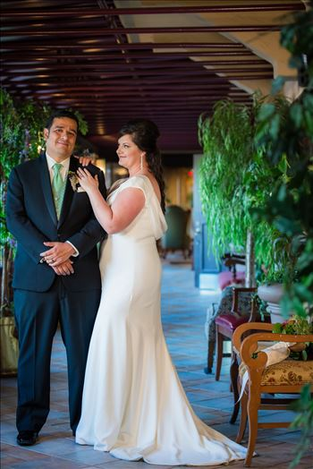 Wedding photography at the Historic Santa Maria Inn in Santa Maria, California by Mirror's Edge Photography. Bride and Groom in breezeway between the Taproom and the Front Desk at the Santa Maria Inn.