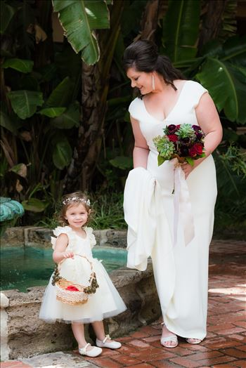 Wedding photography at the Historic Santa Maria Inn in Santa Maria, California by Mirror's Edge Photography. Bride and flower girl