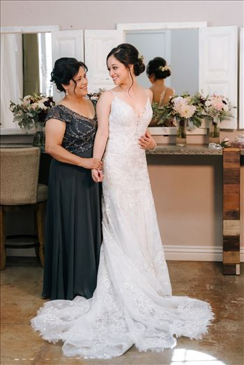 Mirror's Edge Photography captures Edith and Kyle's wedding at the Tooth and Nail Winery in Paso Robles California. Bride getting in to her dress