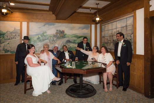 Wedding photography at the Historic Santa Maria Inn in Santa Maria, California by Mirror's Edge Photography.  Bride and Groom the Poker table