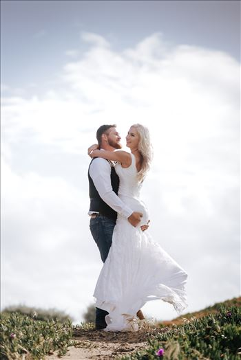 Mirror's Edge Photography, a San Luis Obispo County Wedding and Engagement Photographer, captures Sarah and Jeremy's intimate wedding on Pismo State Beach in Grover Beach, California.  Bride and Groom in the clouds