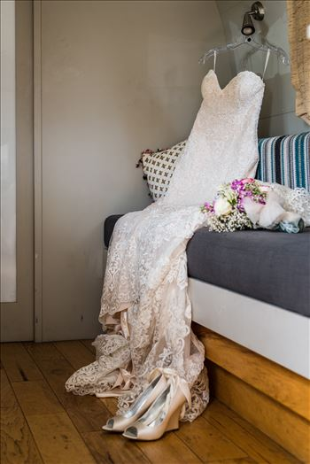 Wedding photography at the Kimpton Goodland Hotel in Santa Barbara California by Mirror's Edge Photography.  Wedding dress, flowers and shoes in Airstream