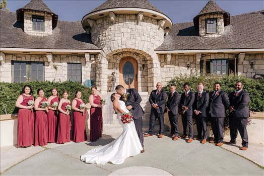 Sarah Williams of Mirror's Edge Photography captures the gorgeous fairy tale wedding day of Victoria and Esteban at the Castle Noland Wedding Venue in San Luis Obispo, California.  The wedding party bridesmaids and groomsmen in front of the castle