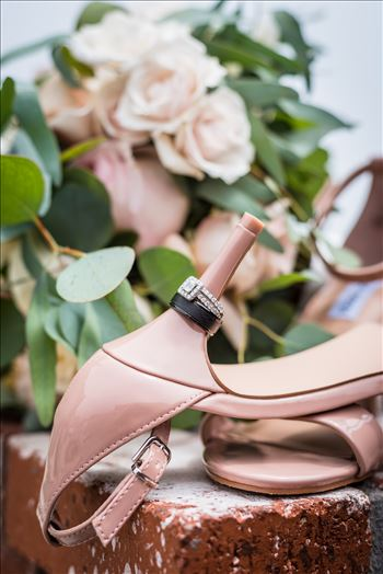 Cayucos California Beach and Bluffs Wedding near Morro Bay and Cambria with romantic chic flair by Mirror's Edge Photography, San Luis Obispo County Wedding Photographer.  Wedding rings, flowers and brides shoes