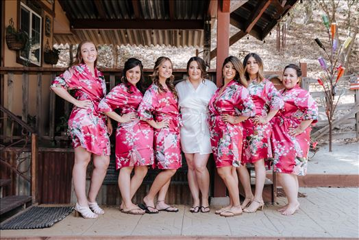 Mirror's Edge Photography captures Madison and Stephen's Wedding at Case de Alvarez in Arroyo Grande, California. Bride and Bridesmaids having fun.