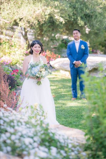 Mirror's Edge Photography captures Maryanne and Michael's magical wedding in the Secret Garden at the iconic Madonna Inn in San Luis Obispo, California. Beautiful Bride in the garden