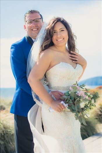Wedding at Dolphin Bay Resort and Spa in Shell Beach, California by Sarah Williams of Mirror's Edge Photography, a San Luis Obispo County Wedding Photographer. Bride and Groom by the Ocean after wedding.