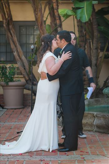 Wedding photography at the Historic Santa Maria Inn in Santa Maria, California by Mirror's Edge Photography. First Kiss of Bride and Groom.