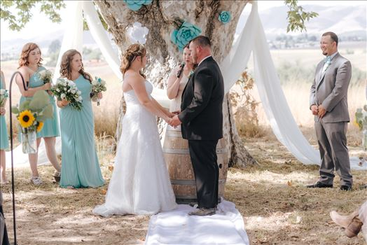 Mirror's Edge Photography, a San Luis Obispo Wedding Photographer, captures a wedding at the Historic Dana Adobe in Nipomo California.  Ceremony under the tree bride and groom.
