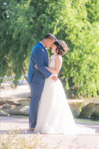 Mirror's Edge Photography captures Maryanne and Michael's magical wedding in the Secret Garden at the iconic Madonna Inn in San Luis Obispo, California. Happy couple by the pond