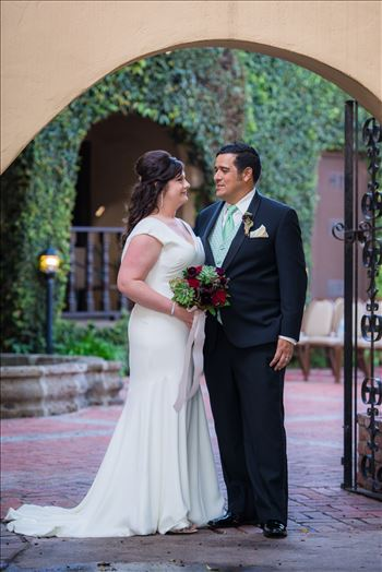 Wedding photography at the Historic Santa Maria Inn in Santa Maria, California by Mirror's Edge Photography. Bride and Groom in Hidden Courtyard.