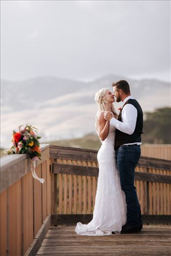 Mirror's Edge Photography, a San Luis Obispo County Wedding and Engagement Photographer, captures Sarah and Jeremy's intimate wedding on Pismo State Beach in Grover Beach, California.  Bride and Groom dancing on the boarding to Pismo