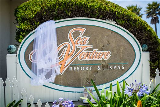 Sea Venture Resort and Spa Wedding Photography by Mirror's Edge Photography in Pismo Beach, California. Wedding Day Sign