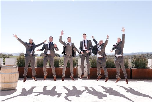 Mirror's Edge Photography captures Edith and Kyle's wedding at the Tooth and Nail Winery in Paso Robles California. Groom and Groomsmen do the jump.