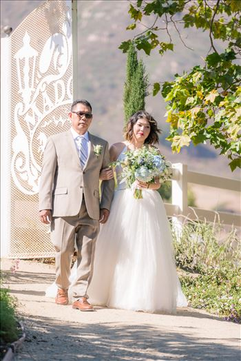 Mirror's Edge Photography captures Maryanne and Michael's magical wedding in the Secret Garden at the iconic Madonna Inn in San Luis Obispo, California. Bride and father enter the Secret Garden
