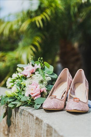 Wedding at Dolphin Bay Resort and Spa in Shell Beach, California by Sarah Williams of Mirror's Edge Photography, a San Luis Obispo County Wedding Photographer. Shoes, flowers and rings