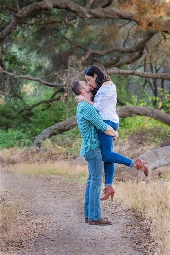 Los Osos State Park Reserve Engagement Photography and Wedding Photography by Mirror's Edge Photography.  Holding her up with a kiss