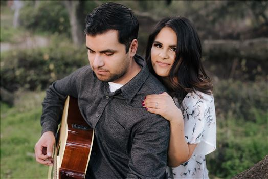 Mirror's Edge Photography captures CiCi and Rocky's Sunrise Engagement in Los Osos California at Los Osos Oaks Reserve. Guitar at engagement session