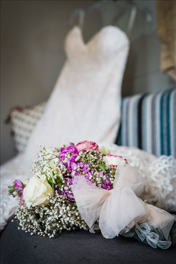 Wedding photography at the Kimpton Goodland Hotel in Santa Barbara California by Mirror's Edge Photography.  Wedding Flowers and dress in Airstream