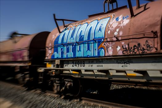 Colorful urban artwork on oil tankers on train tracks
