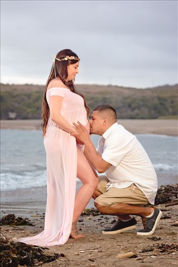 Maternity Photography session at Spooner's Cove at Montana de Oro in Los Osos California.  Beach Maternity Session. Dad kisses the baby bump