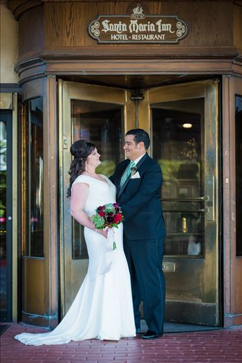 Wedding photography at the Historic Santa Maria Inn in Santa Maria, California by Mirror's Edge Photography. Bride and Groom in revolving door.