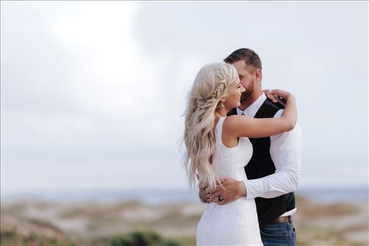 Mirror's Edge Photography, a San Luis Obispo County Wedding and Engagement Photographer, captures Sarah and Jeremy's intimate wedding on Pismo State Beach in Grover Beach, California.  Bride and Groom with ocean in the background