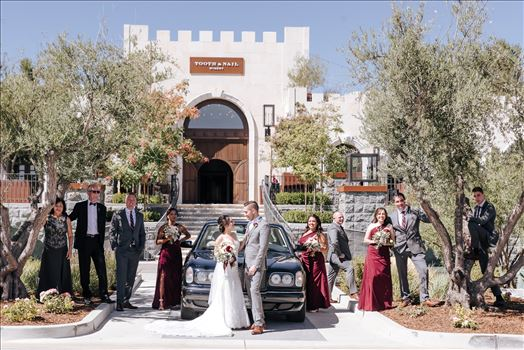 Mirror's Edge Photography captures Edith and Kyle's wedding at the Tooth and Nail Winery in Paso Robles California. Bride, Groom and family by the getaway car