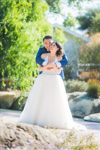 Mirror's Edge Photography captures Maryanne and Michael's magical wedding in the Secret Garden at the iconic Madonna Inn in San Luis Obispo, California. Happy couple in the garden