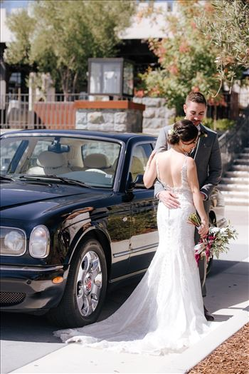 Mirror's Edge Photography captures Edith and Kyle's wedding at the Tooth and Nail Winery in Paso Robles California. Bride and Groom by the Bentley